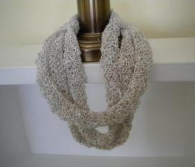 Multistrand necklace knit with linen mix ivory colored yarn.
